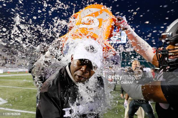 Water is dumped on head coach Tim Lewis of Birmingham Iron following a victory over the Memphis Express during an Alliance of American Football game...