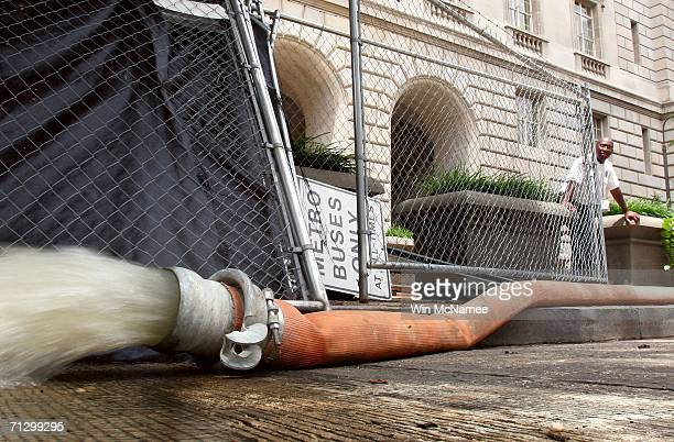 Water is pumped out of the Internal Revenue Service Building after heavy flooding June 26 2006 in Washington DC More than 5 inches or rain fell in...