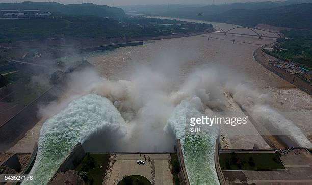 TOPSHOT Water is released from the floodgates of the Xiaolangdi dam on the Yellow River near Luoyang in China's Henan province on June 29 2016 The...