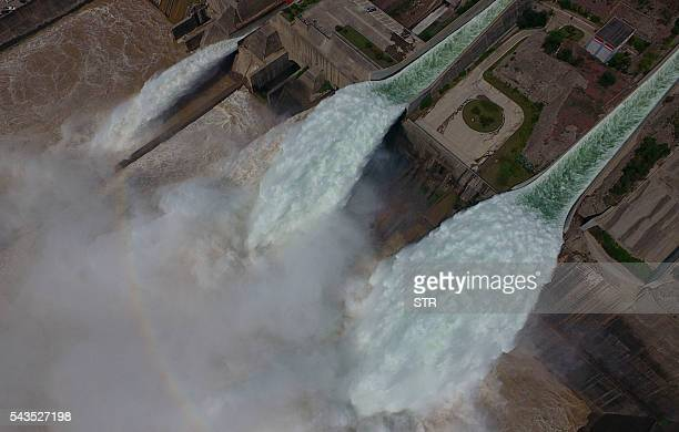 Water is released from the floodgates of the Xiaolangdi dam on the Yellow River near Luoyang in China's Henan province on June 29 2016 The floodgates...