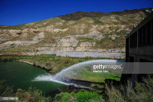 Water is released into the Yarmouk river, a waterway that flows through the al-Wehda Dam, a 360-foot concrete embankment, near Harta, Jordan, Sunday...