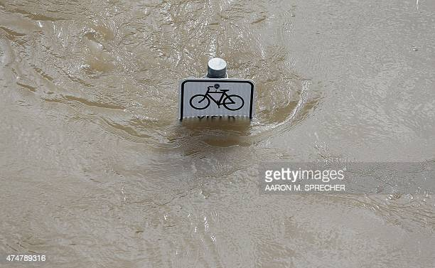 Water is seen at the top of a sign along a bike path near Memorial Drive in Houston Texas on May 26 2015 Heavy rains throught Texas put the city of...