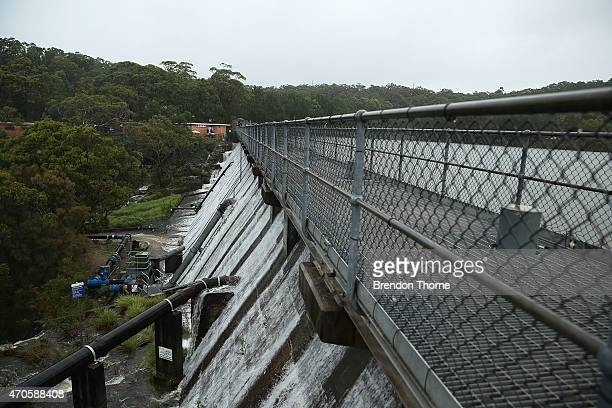 Water is seen spilling over Manly Dam on April 22 2015 in Sydney Australia Three people have died and more than 200000 are still without power as...