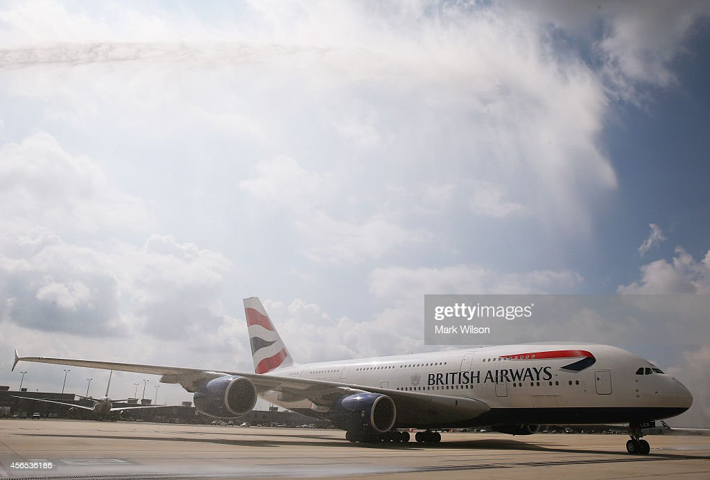 Water is sprayed from a fire truck to welcome British Airways' new super jumbo Airbus A380 as it taxies to its gate at Washington Dulles International Airport October 2, 2014 in Dulles, Virginia. British Airways introduced the first Airbus A380 nonstop service between London Heathrow and Washington Dulles International Airport.