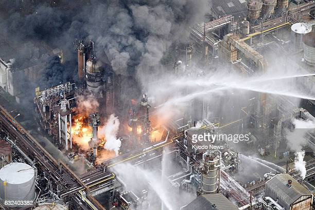 Water is sprayed on a TonenGeneral Sekiyu KK refinery in the city of Arida Wakayama Prefecture western Japan after a fire broke out on Jan 22 2017...