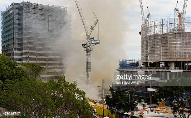 Water is sprayed on the site of a fire at the Barangaroo construction site which threw plumes of smoke over Sydney's central business district on...