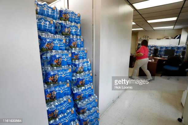Water is stacked in several rooms scattered around the Newark Health Department which is acting as a distribution point for fresh water for residents...