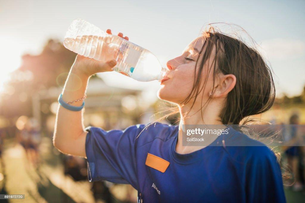 ¡El agua es el combustible para el ejercicio! : Foto de stock