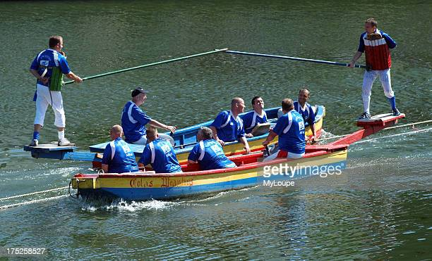 Water jousting in Arras northern France. The game involves two teams in two boats one team member has a pole with which he must knock an opposing...