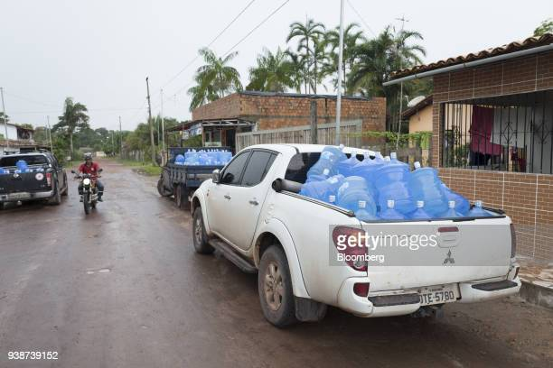 Water jugs sit in the back of local government trucks for distribution following concerns when Norsk Hydro ASA discharged untreated water into a...