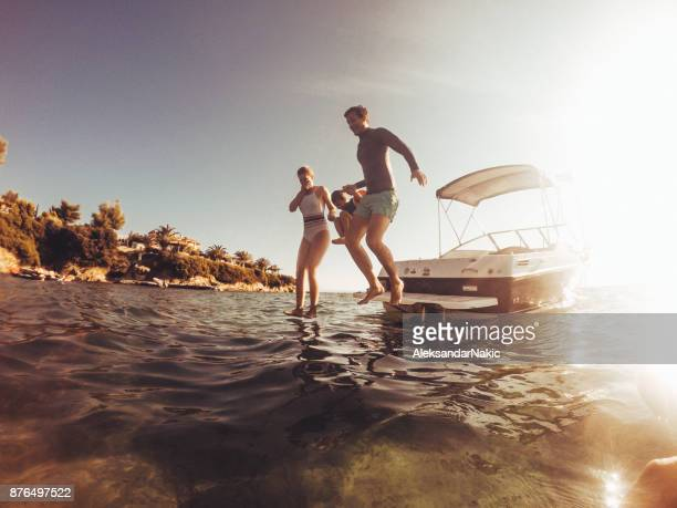 water jumping with my family - small boat stock pictures, royalty-free photos & images
