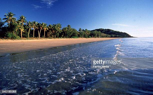 Water laps at the shore of a beach in Port Douglas in north Queensland 26 March 2002 AFR Picture by ROBERT ROUGH