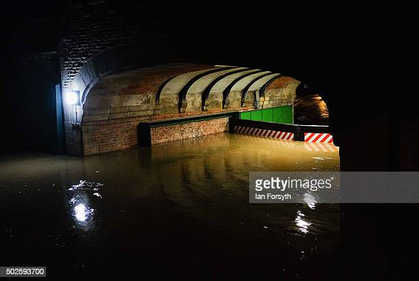 Water levels rise high against a flood barrier as water floods from the river Ouse on December 27 2015 in York England Heavy rain over the Christmas...