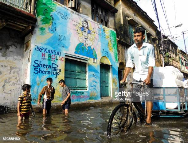 A water logged scene in a street around Central Kolkata Monsoon season in kolkata lasts from mid March to end of September and during these period...