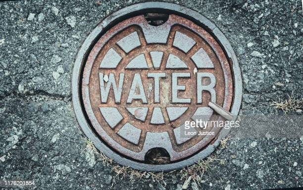 water main cover - sewer stock pictures, royalty-free photos & images