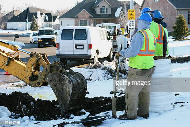 water main workers - winter weather stock photos and pictures