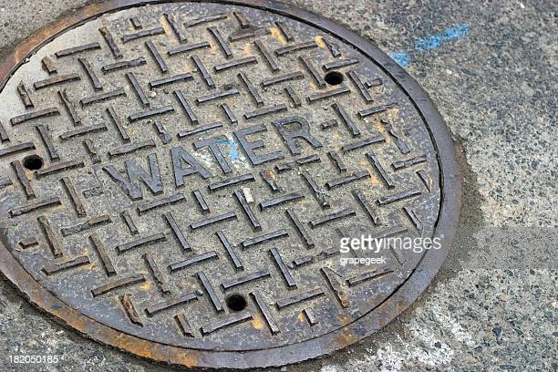 water manhole cover - sewer stock pictures, royalty-free photos & images