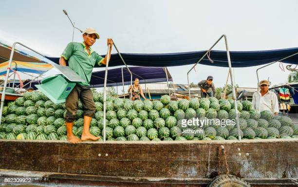 water melon selling boat in the river - Floating market at Nga Nam Soc Trang