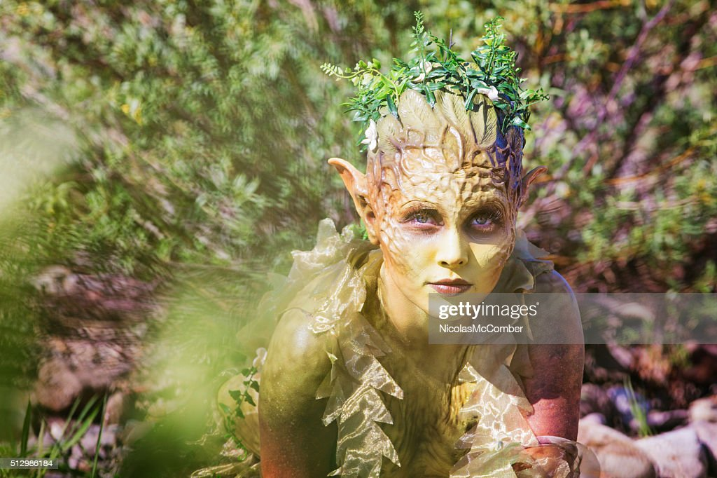 Water Nymph portrait emerging from bushes : Stock Photo