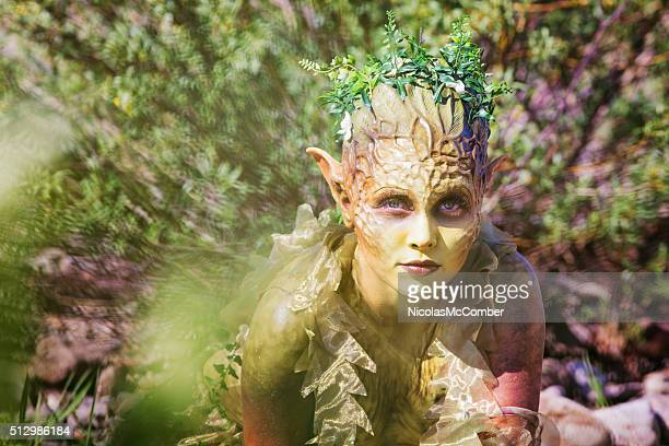 water nymph portrait emerging from bushes - fairy stock photos and pictures