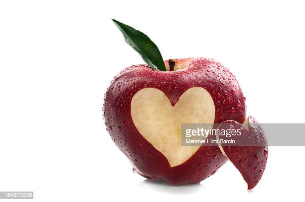 Water on Red Apple With Heart Shape