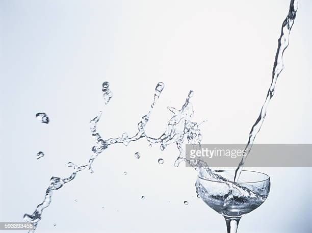 Water overflowing from glass