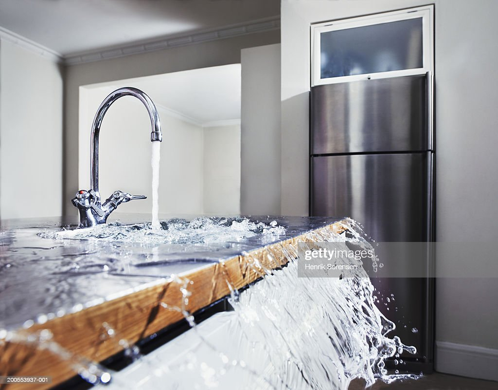 Water Overflowing In Kitchen Sink Stock Photo Getty Images