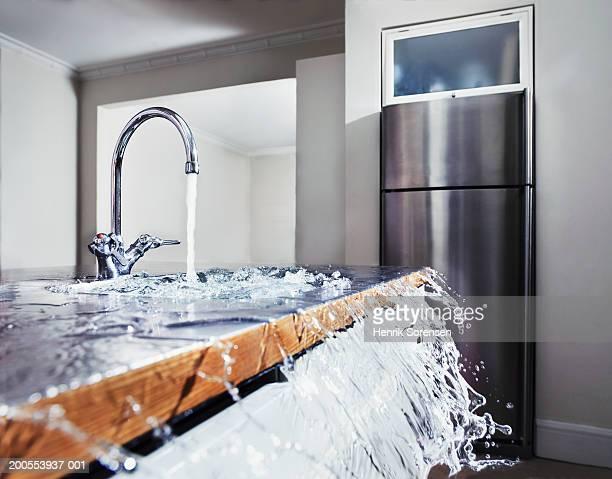 Water overflowing in kitchen sink