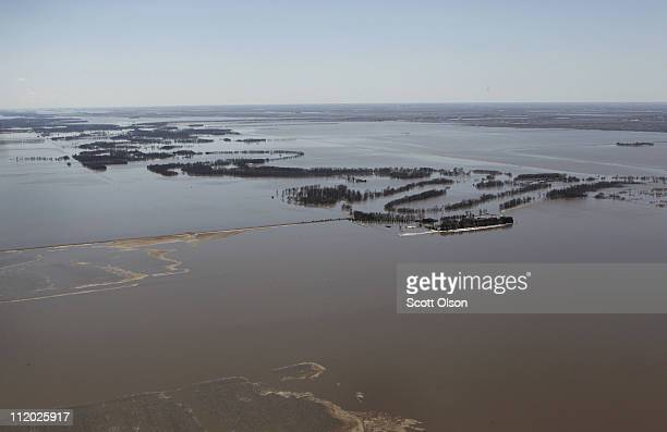 Water overflows the banks of the Red River on April 11 2011 near Fargo North Dakota The river is normally contained within the tree line Although the...