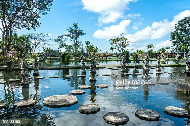 Water palace a maze of pools and fountains surround by a lush garden and stone carvings and statues
