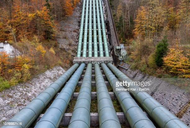 water pipeline of hydroelectric power plant in forest during autumn - pipeline stock pictures, royalty-free photos & images