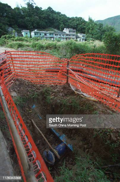 Water pipes being laid near vacant village houses in Kau Tam Tso Tai Po 09 December 2002