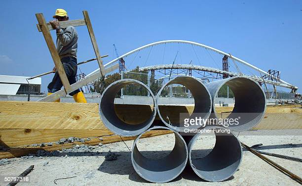 Water pipes lay beside the unfinished pedestrian walkway around the perimeter of the main Olympic Stadium on May 3 2004 in Athens Greece The gigantic...