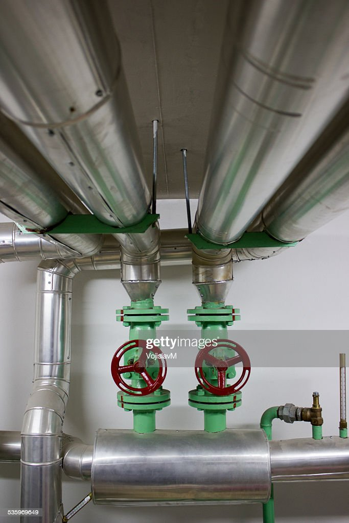 Water pipes vertical with valves 2 : Stock Photo