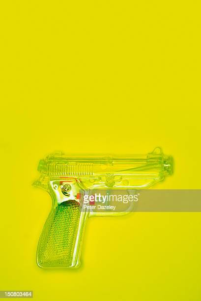 Water pistol on a yellow background