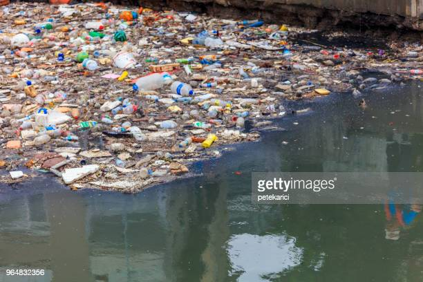 water pollution - polluting the seas - water pollution stock pictures, royalty-free photos & images