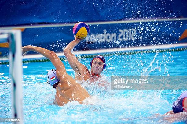 2012 Summer Olympics USA Jesse Smith in action vs Hungary Daniel Varga during Men's Preliminary Round Group B game at Water Polo Arena London United...