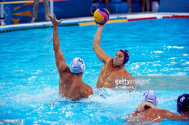 Summer Olympics: USA Tony Azevedo and Jesse Smith in action vs Hungary Tamas Kasas during Men's Preliminary Round - Group B game at Water Polo Arena....