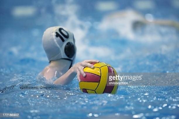 water polo game with ball on the water - water polo stock pictures, royalty-free photos & images