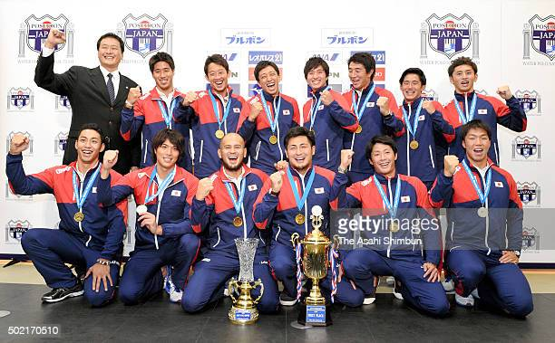 Water Polo Japan Men's team members pose for photographs after a press conference on arrival at Haneda International Airport on December 21 2015 in...