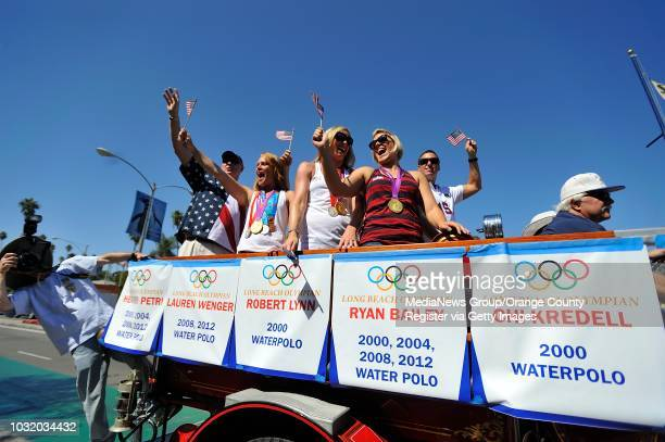 BEACH CALIF USA Water polo Olympians including Heather Petri left Lauren Wenger and Kami Craig during parade honoring Long Beach Olympians in Belmont...