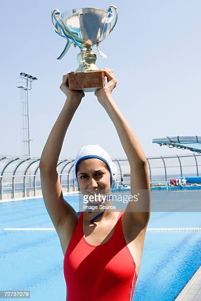 water polo player holding trophy - water polo stock pictures, royalty-free photos & images