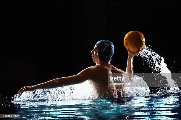 Water polo player throwing the ball
