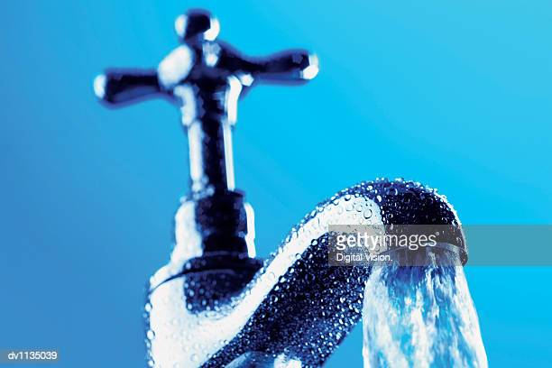 Water Pouring From a Faucet
