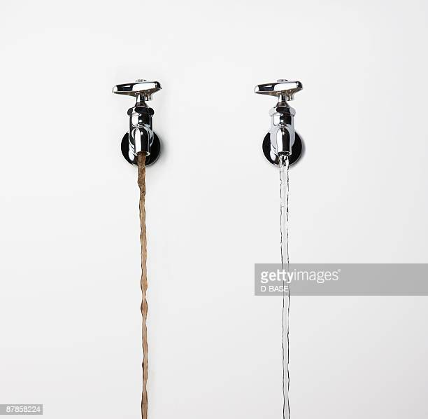 Water Pouring from Faucet