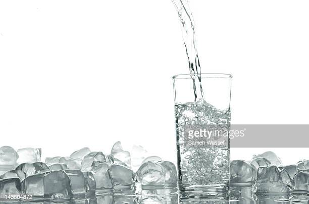 Water pouring in to glass