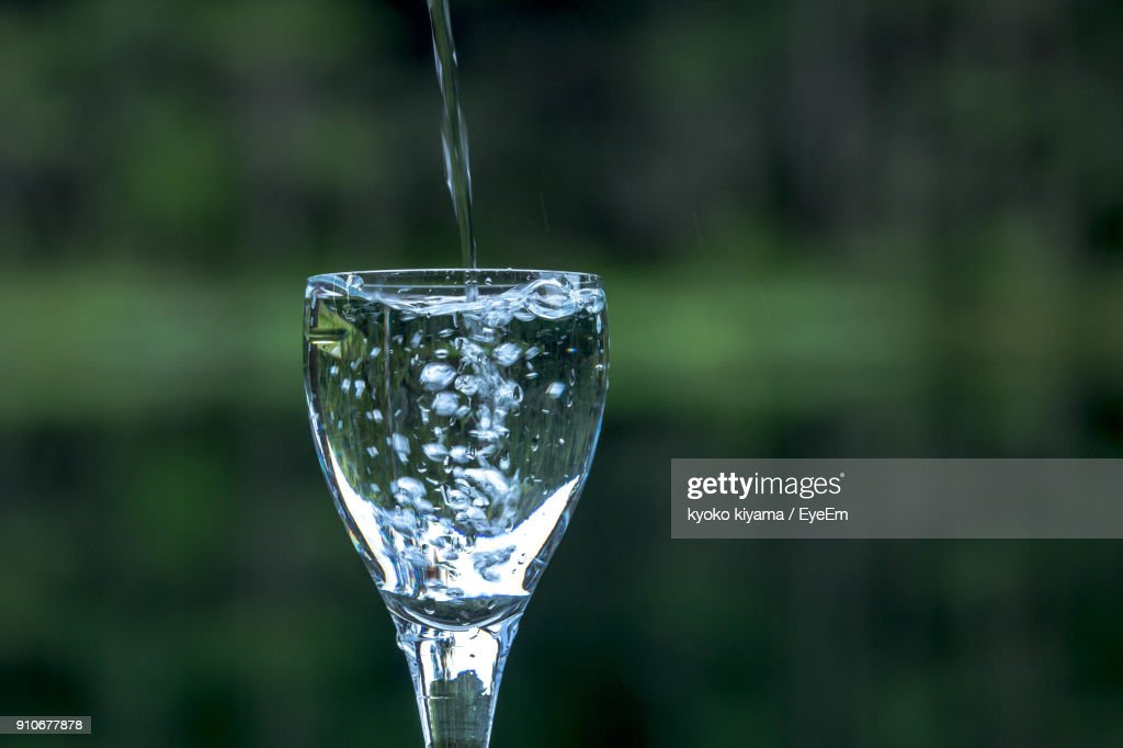 Water Pouring In Wineglass Stock Photo Getty Images