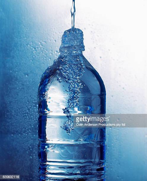 Water Pouring into Bottle