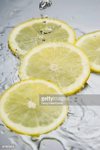 Water Pouring on Lemon Slices