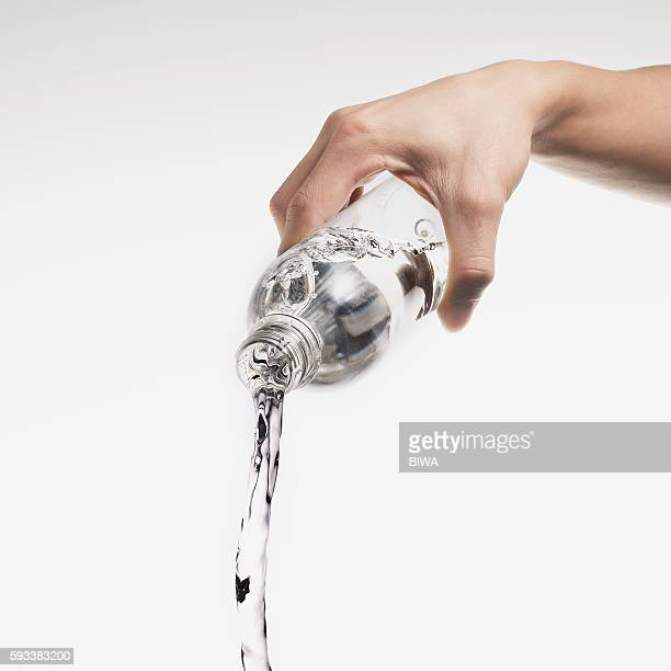 Water Pouring Out of Plastic Bottle